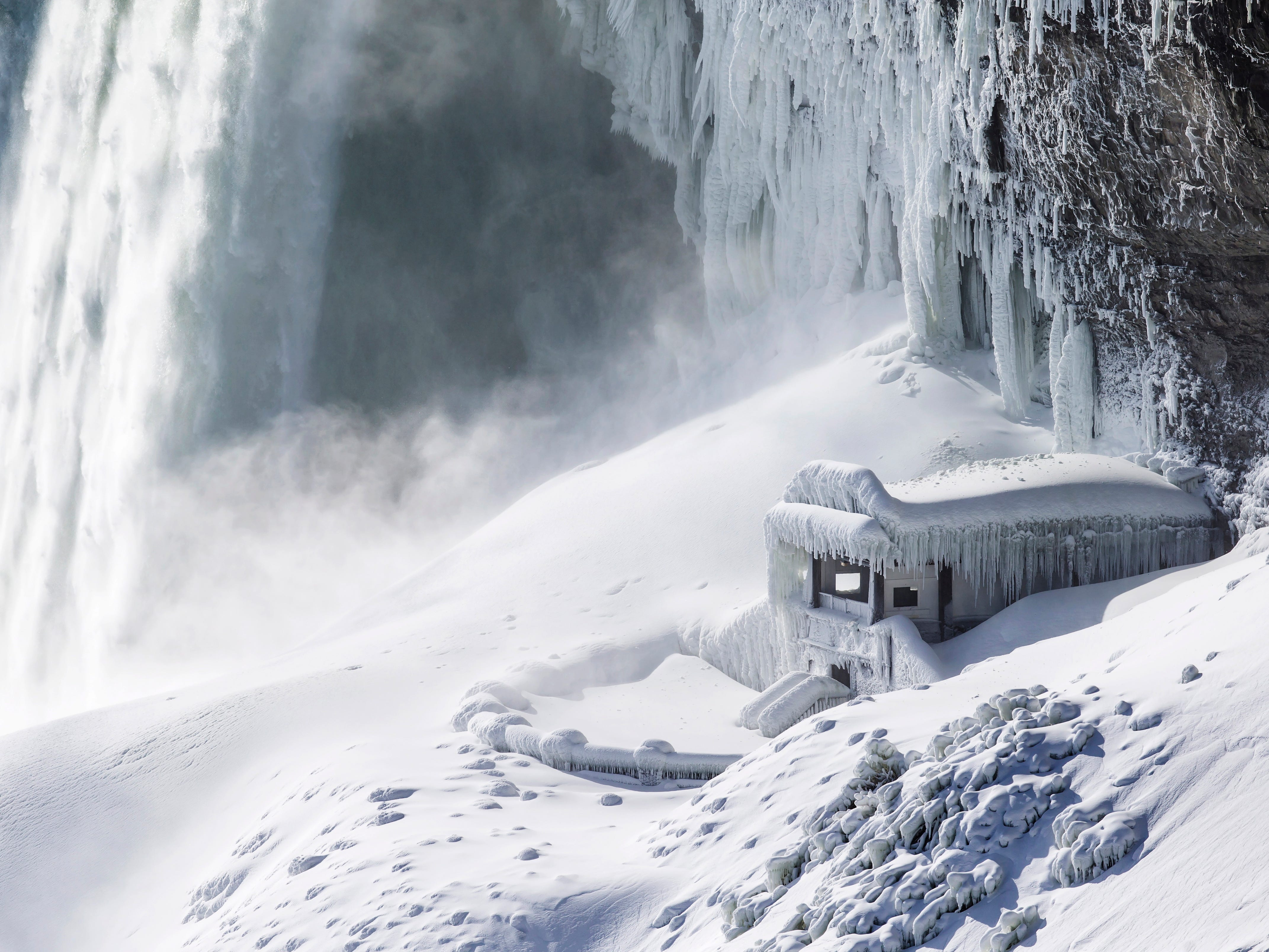 Ice covers the observation deck at the base of Horseshoe falls in Niagara Falls, Ontario, Canada Thursday, Jan. 31, 2019.