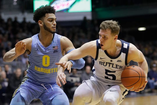 Butler's Paul Jorgensen (5) is defended by Marquette's Markus Howard (0) during the first half.