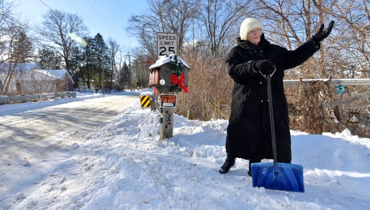 When asked if she's gonna continue shoveling, Sandra Campos says with authority, 'give me a minute, I'm takin a break, I'm 80-years-old,' before continiuing to shovel out the mailboxes at her residence on Lake Orion near the Indianwood Golf and Country Club 'Old Course,' (established in 1925.) Then Campos, a former bartender, says she has a 1.5 bedroom apartment for rent for $650 a month plus half the utilities and extra rent for the use of her boat dock. 'Find me someone with ambition, muscles and who doesn't mind helping out around here,' she says before going inside to get warm, Thursday afternoon, January 31, 2019. (Todd McInturf, The Detroit News)2019.