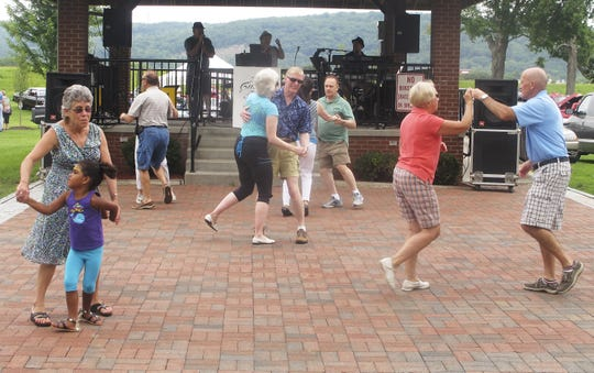 People dance during the Olde Tyme Summer Festival at Brand Park in Elmira.