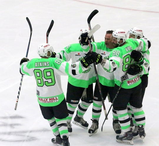 Elmira Enforcers owner Robbie Nichols, center with no helmet, celebrates with players after scoring the first goal of the game in an exhibition against the New York Police Department hockey team Jan. 30, 2019 at First Arena in Elmira.