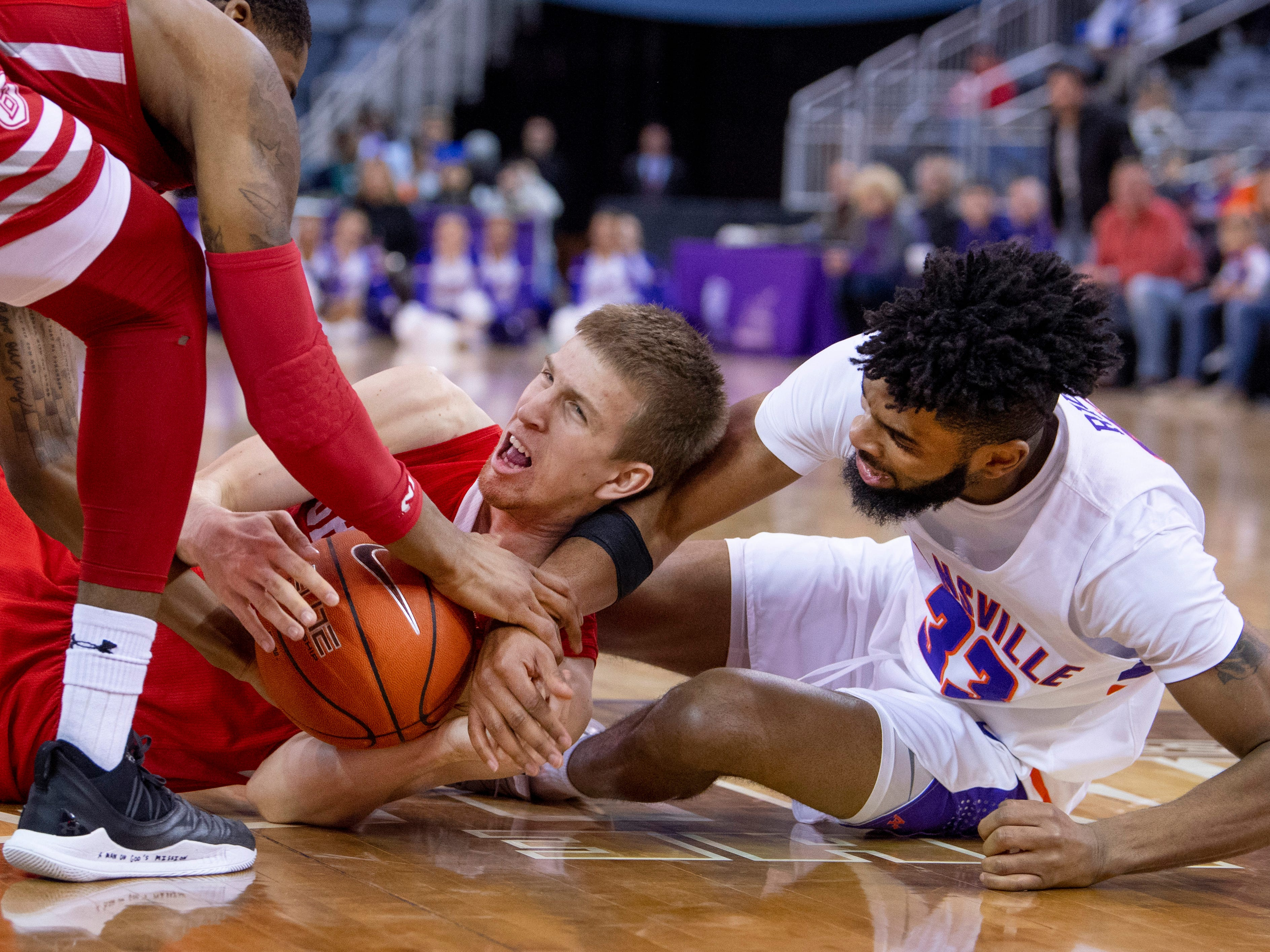 Bradley's Nate Kennell (25) comes up with the ball ahead of Evansville's K.J. Riley (33) during their game at the Ford Center Wednesday night.