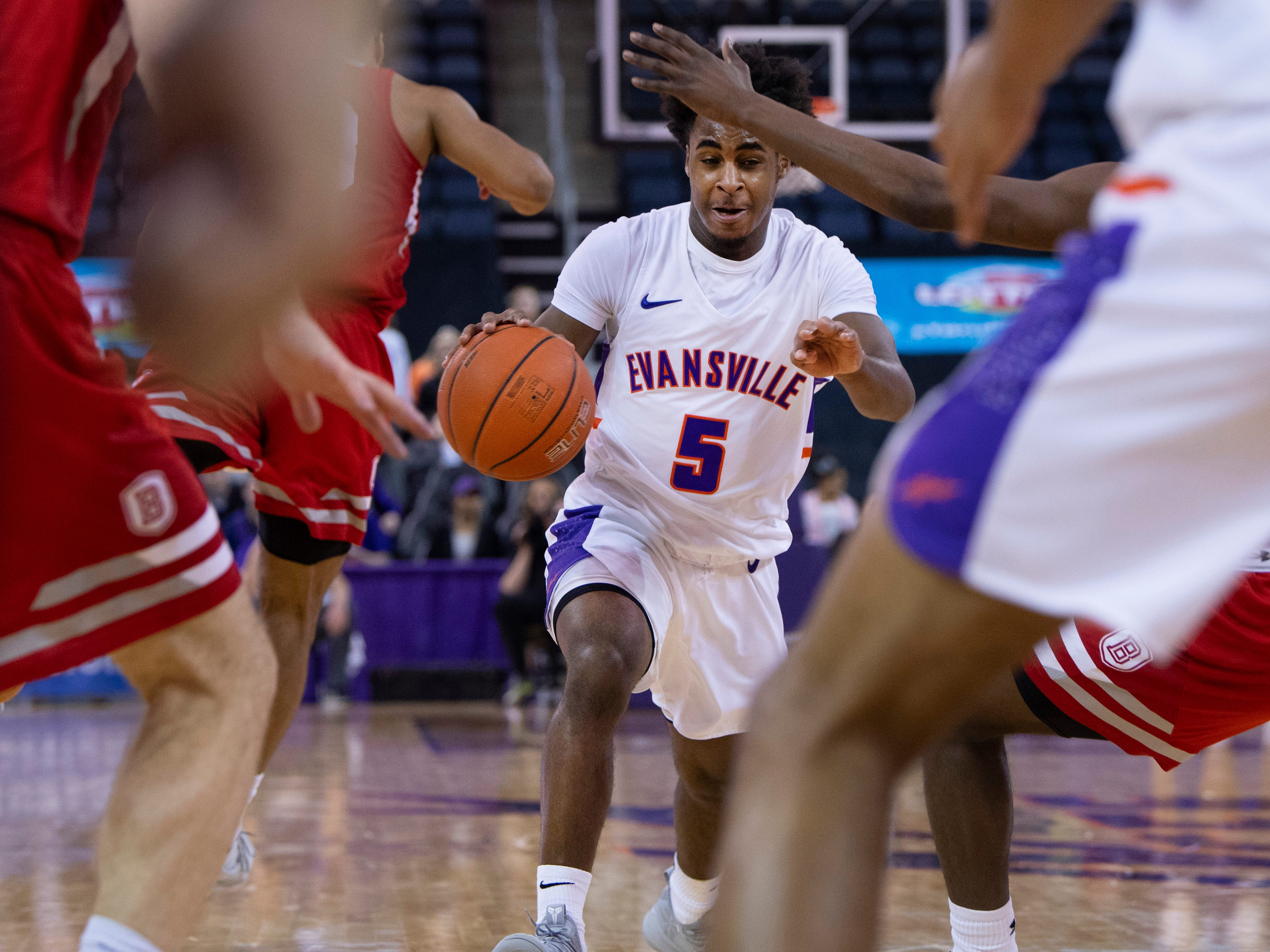 Evansville's Shamar Givance (5) drives the paint against Bradley during their game at the Ford Center Wednesday night.