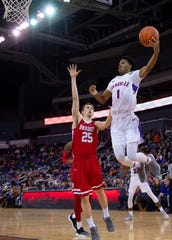 Evansville's Marty Hill (1) goes high to bring down a pass against Bradley's Nate Kennell (25) during their game at the Ford Center Wednesday night.