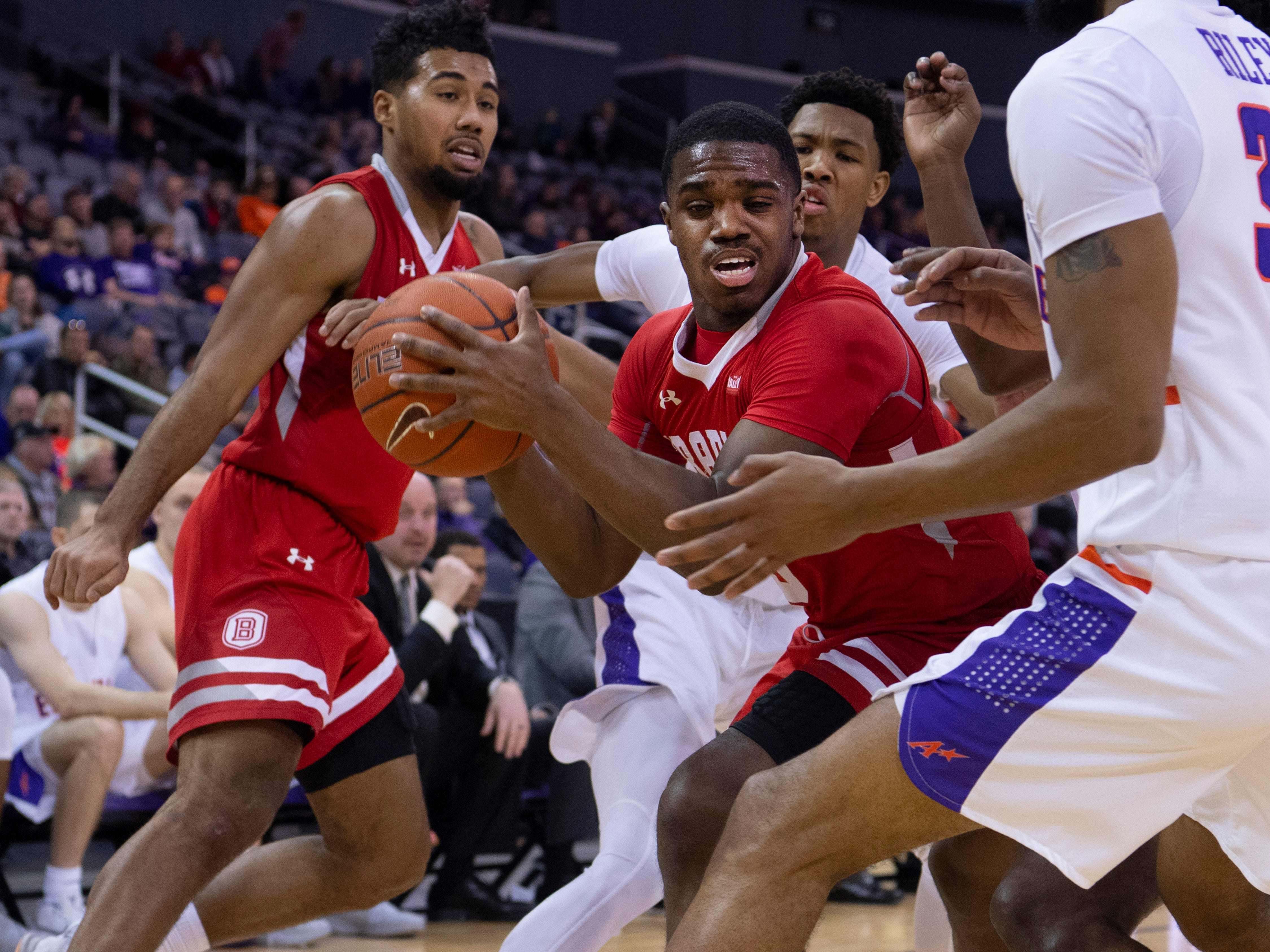 Bradley's Darrell Brown (5) is pressured by Evansville's defense during their game at the Ford Center Wednesday night.