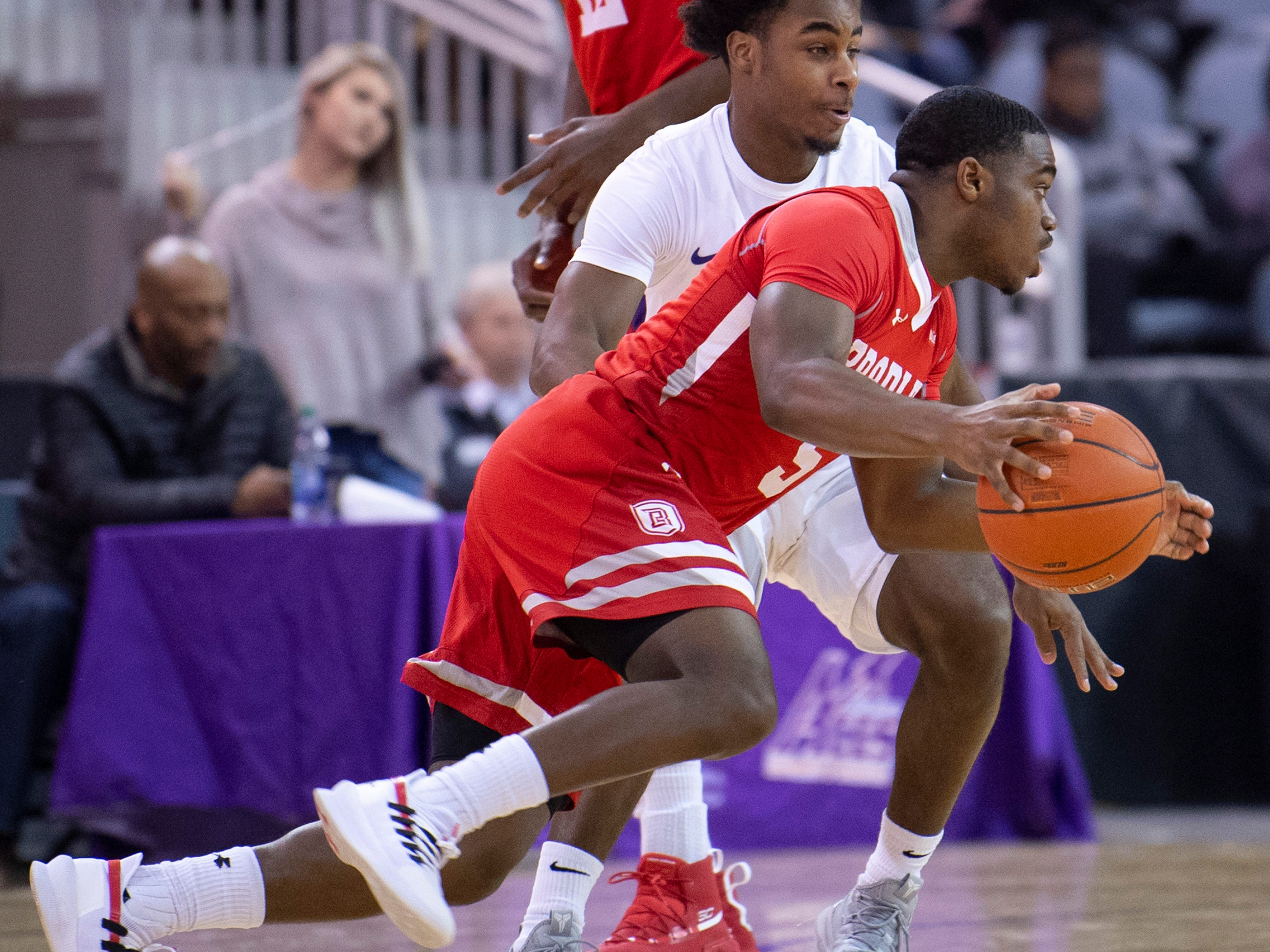 Bradley's Darrell Brown (5) drives past Evansville's Shamar Givance (5) during their game at the Ford Center Wednesday night.