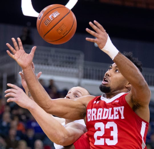 Bradley's Dwayne Lautier-Ogunleye (23) and Evansville's Dainius Chatkevicius (14) fight for a rebound during their game at the Ford Center Wednesday night.