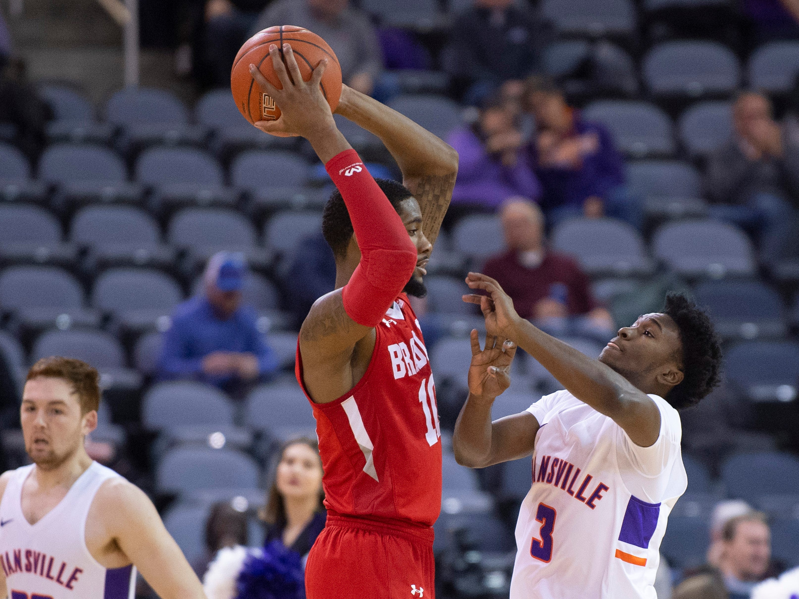 Bradley's Elijah Childs (10) is guarded by Evansville's Jawaun Newton (3) during their game at the Ford Center Wednesday night.