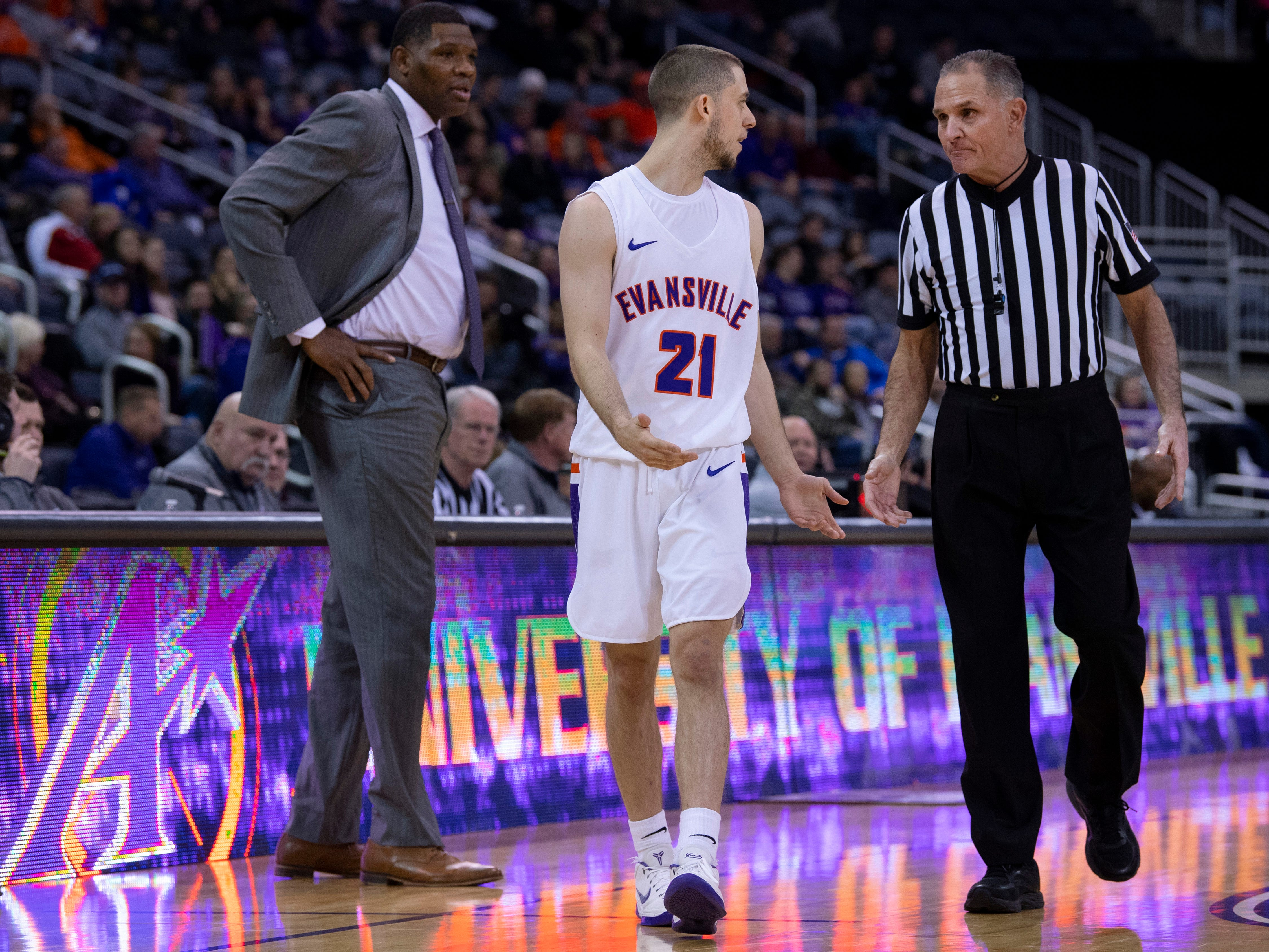 Evansville's Shea Feehan (21) discusses being handed a flagrant one foul against Bradley during their game at the Ford Center Wednesday night.