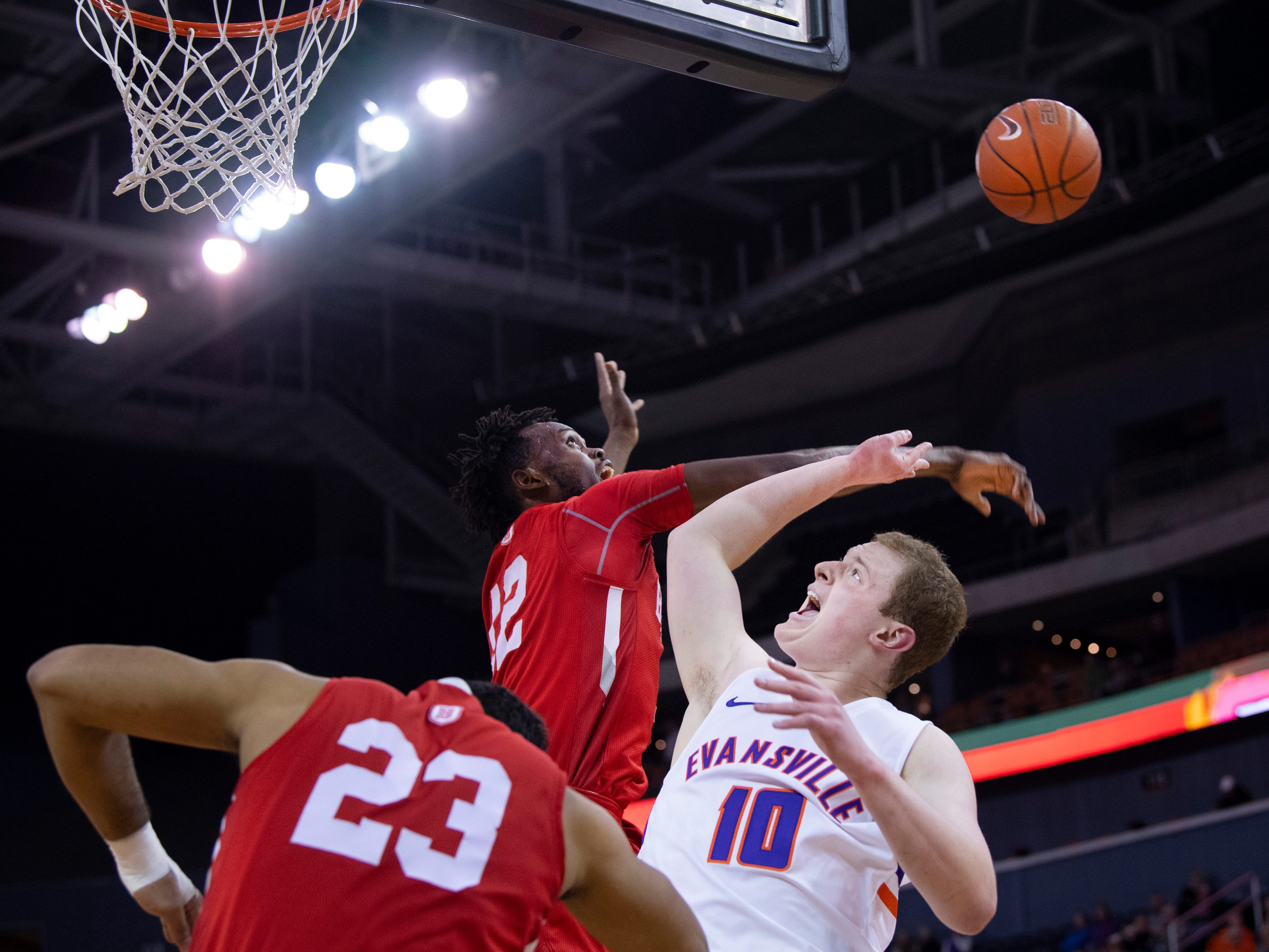 Bradley's Koch Bar (12) blocks Evansville's Evan Kuhlman (10) shot attempt during their game at the Ford Center Wednesday night. Kuhlman was fouled on the play.