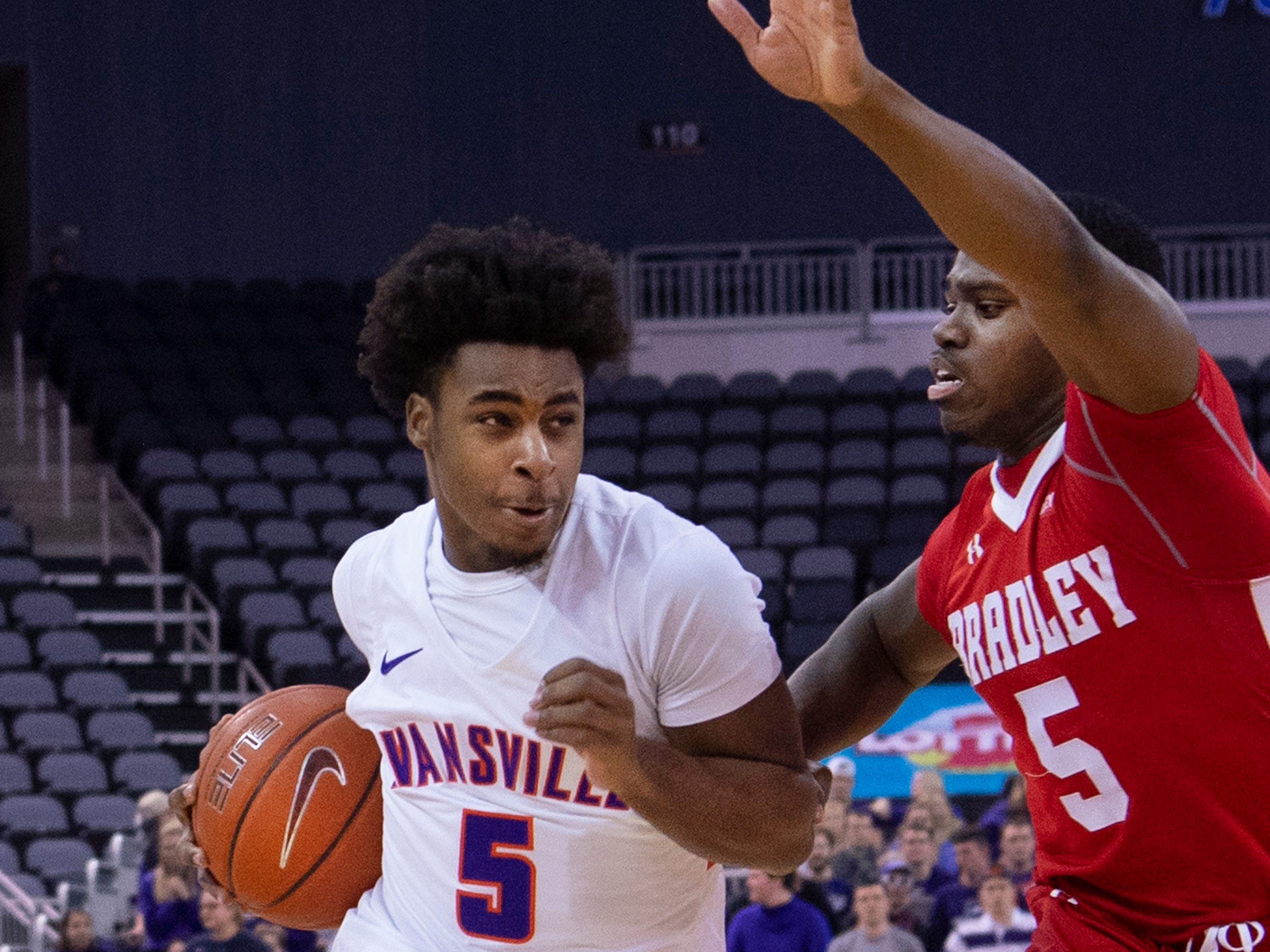 Evansville's Shamar Givance (5) drives past Bradley's Darrell Brown (5) during their game at the Ford Center Wednesday night.