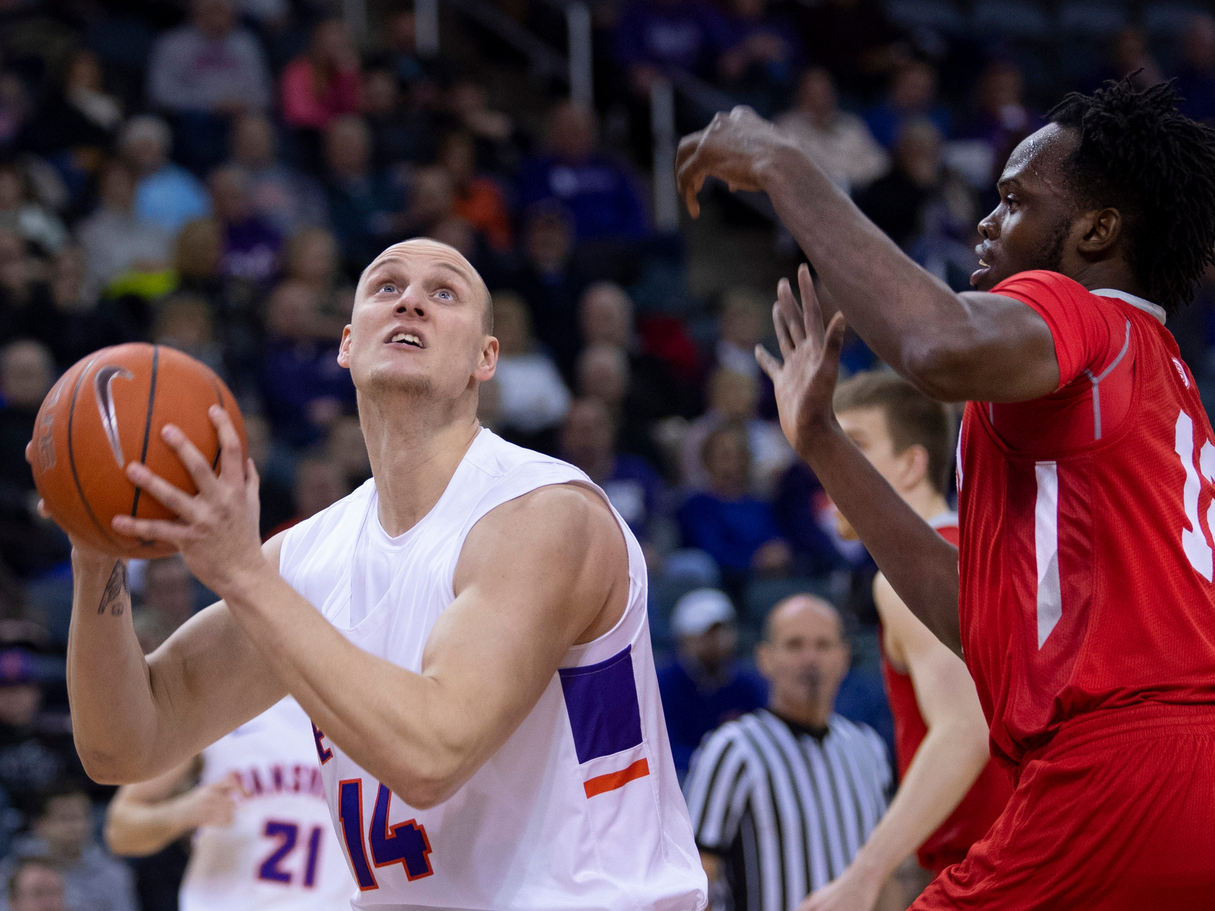 Evansville's Dainius Chatkevicius (14) goes strong to the hoop against Bradley's Koch Bar (12) during their game at the Ford Center Wednesday night.