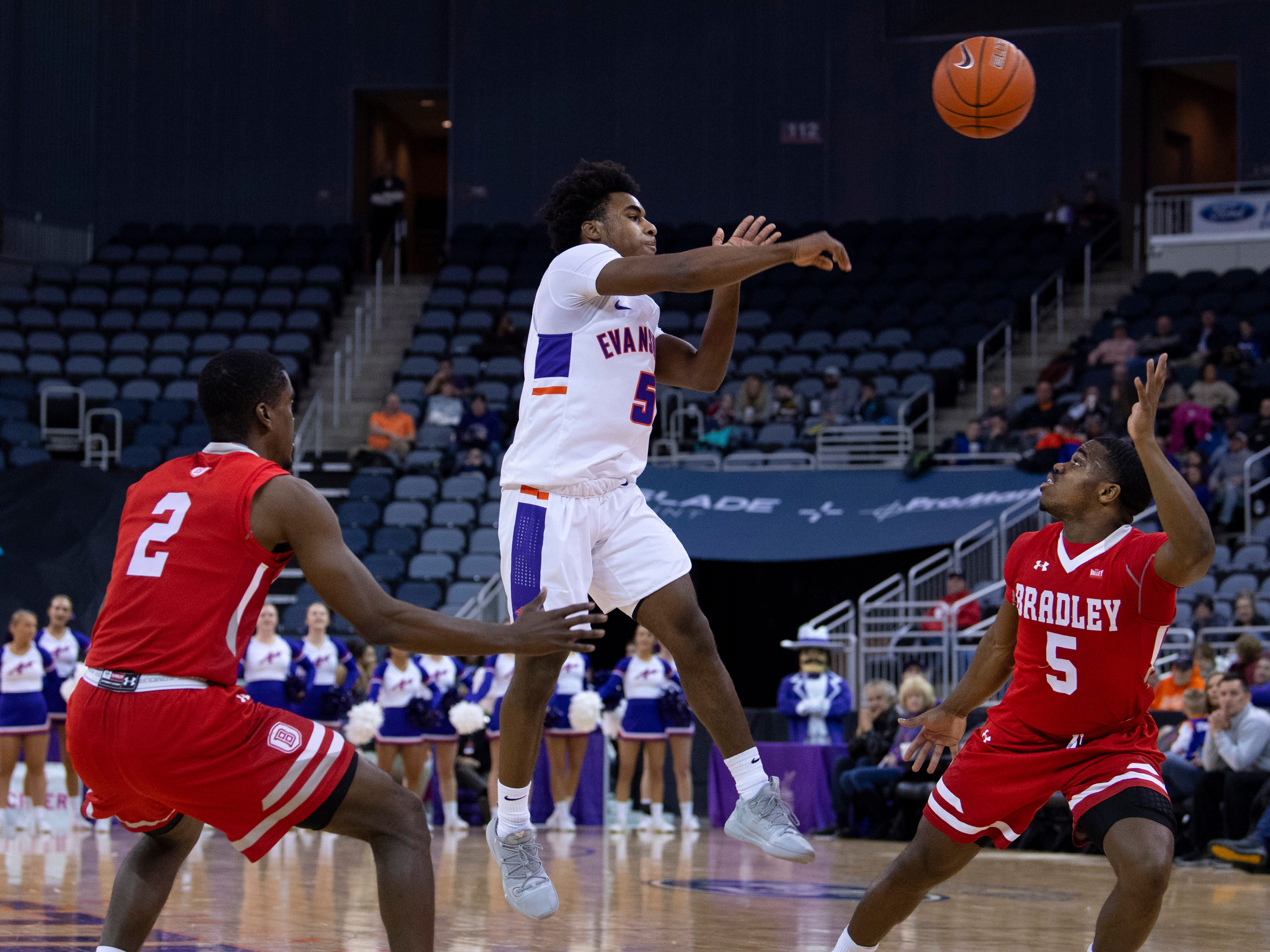 Evansville's Shamar Givance (5) makes a pass over Bradley's Darrell Brown (5) during their game at the Ford Center Wednesday night.