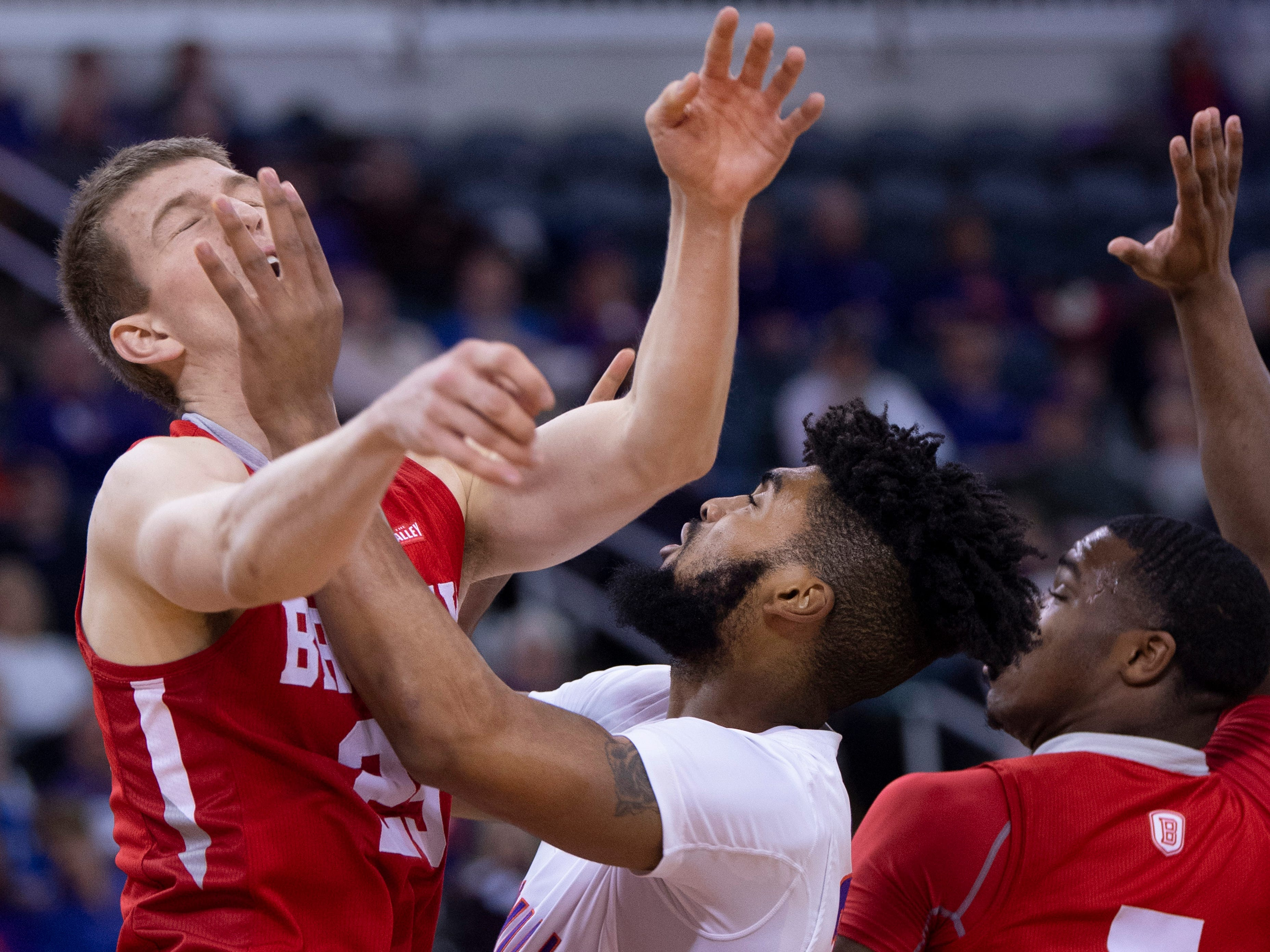 Evansville's K.J. Riley (33) fouls Bradley's Nate Kennell (25) during their game at the Ford Center Wednesday night.