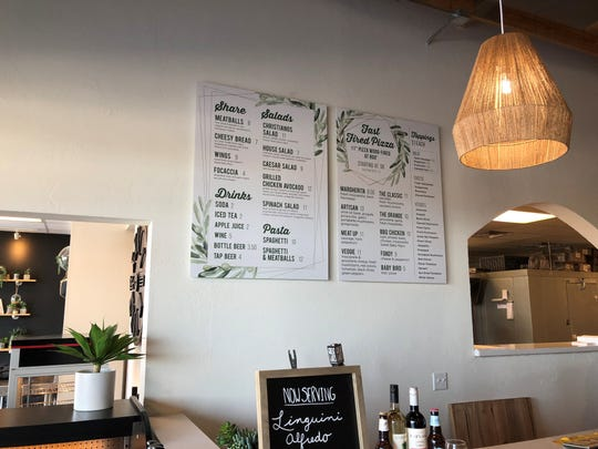 At the front counter, customers can view hand-held menus or those on the wall, as well as choose from craft beers and wines now available.