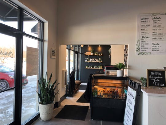 """Succulents and wooden letters spelling """"Pizza"""" and """"Eat"""" sit on shelves at Christianos on South Main Street."""
