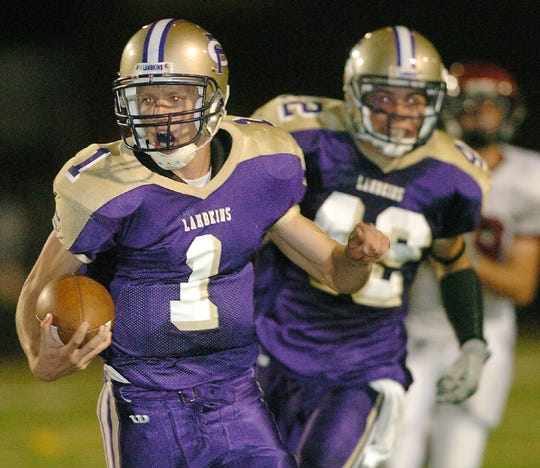 From the archives: Fort Collins High School quarterback Matt Yemm runs for a 37-yard touchdown over Rocky Mountain in 2005. Yemm was hired as the Fort Collins head coach on Thursday.