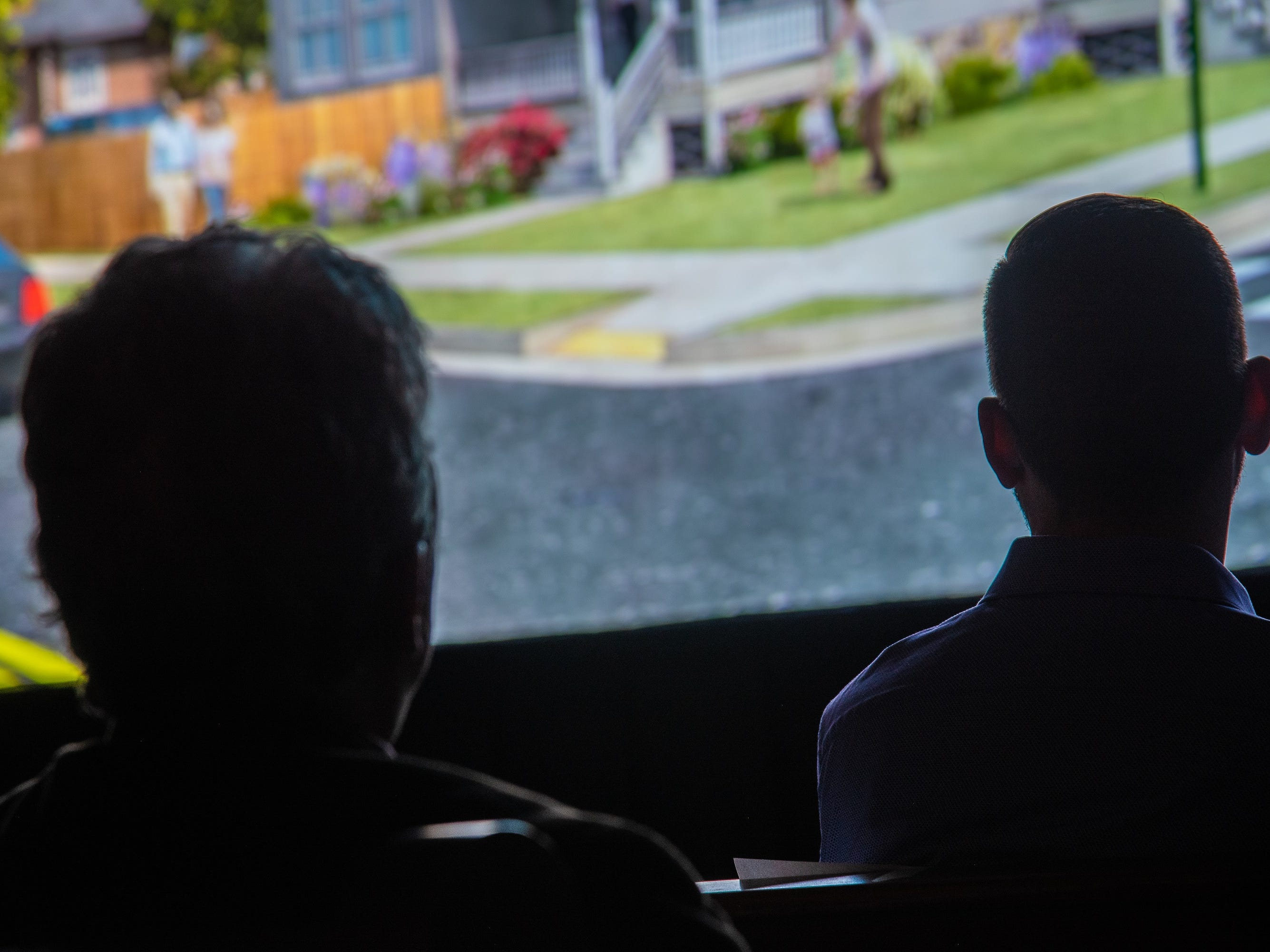 Audience members watch a short film documenting Fort Collins' accomplishments and challenges of 2018 during the annual State of the City Address on Tuesday, January 29, 2019, at the Lyric Cinema in Fort Collins, Colo.