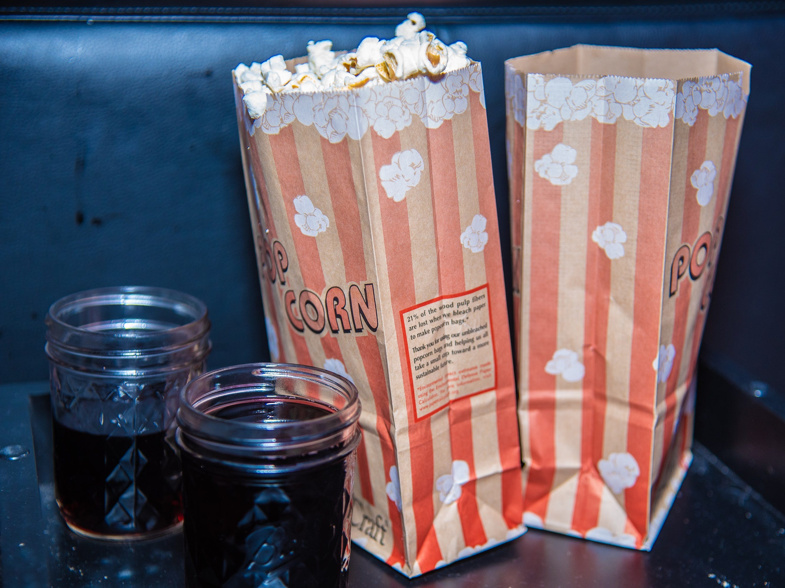 Two bags of complimentary popcorn sit on a table in one of the Lyric Cinema's theaters before the annual State of the City Address on Tuesday, January 29, 2019, in Fort Collins, Colo.