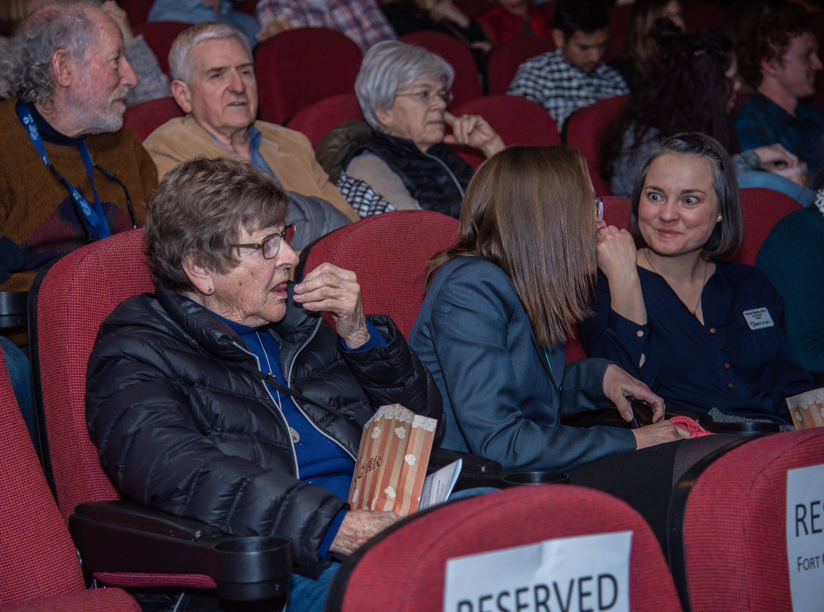 Audience members enjoy complimentary popcorn before the annual State of the City Address on Tuesday, January 29, 2019, at the Lyric Cinema in Fort Collins, Colo.bb