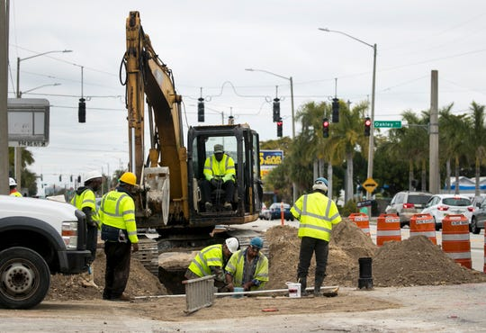 A construction crew from Stevens & Layton, Inc., works on the water line along U.S. 41 in Fort Myers on Thursday, January 30, 2019. The project will replace water and sewer lines, and the road will be repaved.