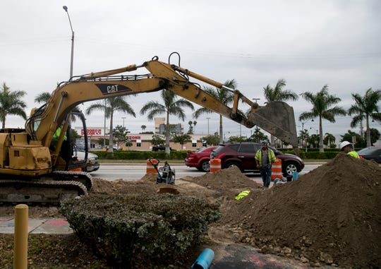 A construction crew from Stevens & Layton, Inc., works on the water line along U.S. 41 in Fort Myers on Wednesday, January 30, 2019. The project will replace water and sewer lines, and the road will be repaved.