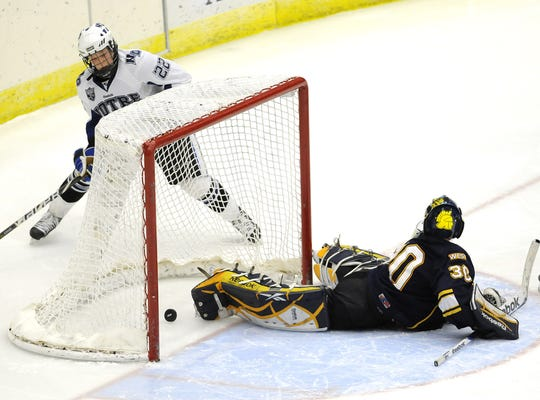 Mason Appleton (22) scored the winning goal in overtime against Wausau West goalie Sam Wiegert (30) in the 2012 WIAA state title game at the Alliant Energy Center in Madison.
