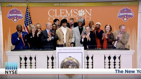 Clemson players gather to ring the final bell Wednesday at the New York Stock Exchange.