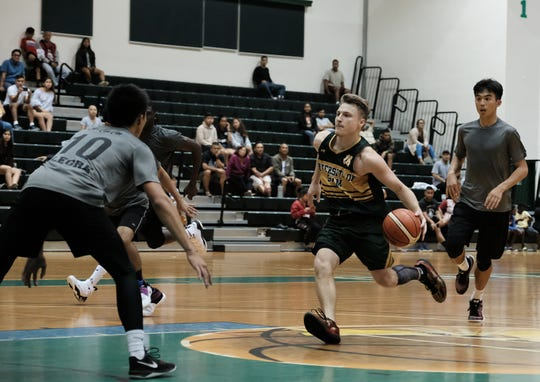 Logan Hopkins led UOG with 32 points in a 87-85 loss to the MacTech Nerds in the Triton Men's Basketball League Jan. 30.
