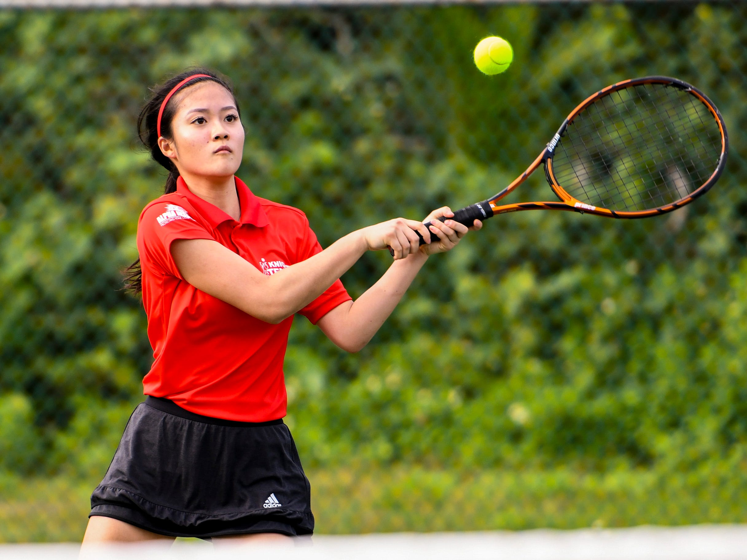 St. John's Knights' Ayaka Lin returns a volley during an Interscholastic Athletic Association of Guam tennis singles match against Academy of Our Lady Guam Cougars' Mika Alcantara at the Rick Ninete Tennis Center in Hagåtna on Thursday, Jan. 31, 2019.