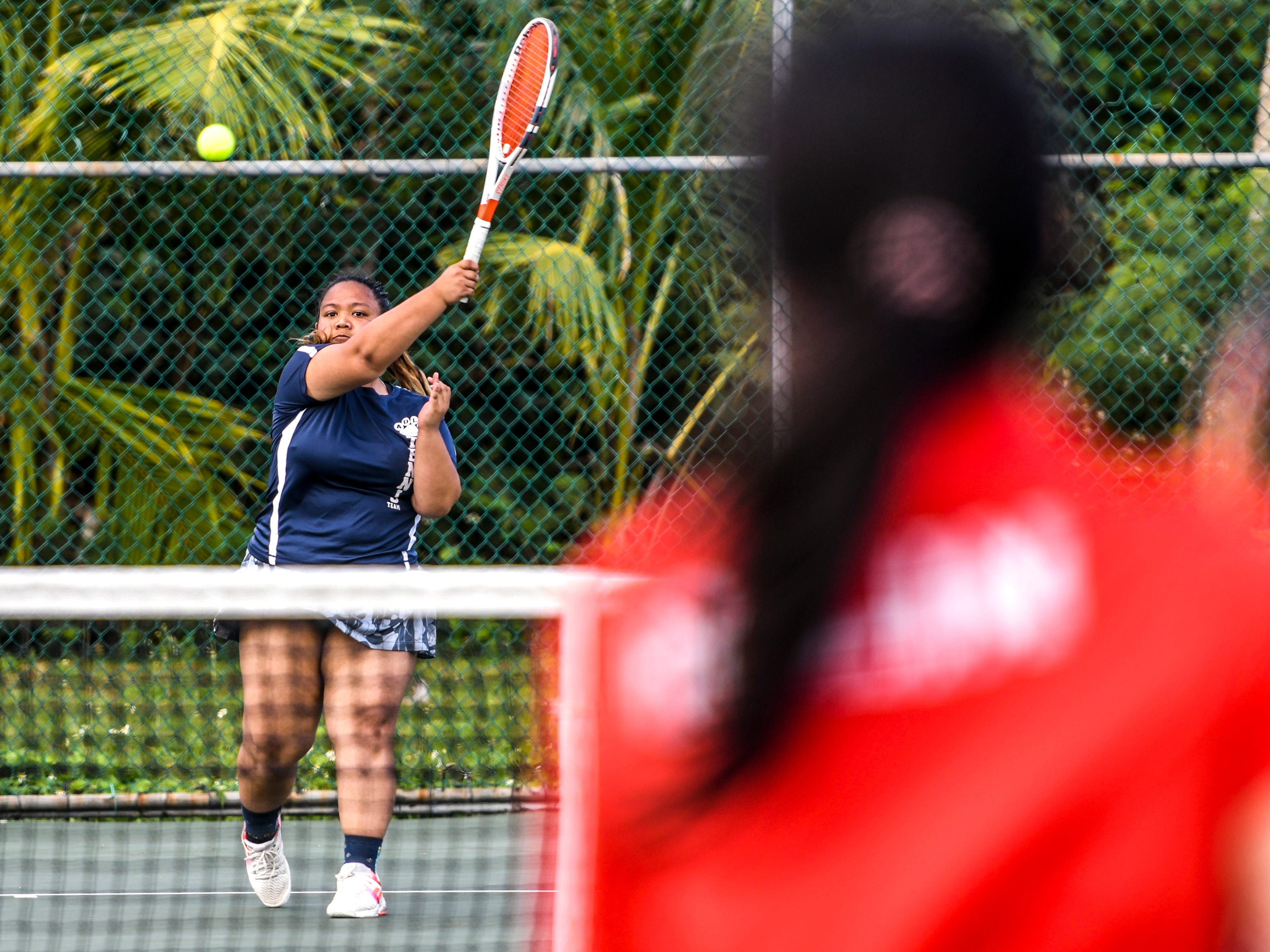 Academy of Our Lady Guam Cougars' Mika Alcantara answers back with forehand volley during an Interscholastic Athletic Association of Guam tennis singles match with St. John's Knights' Ayaka Lin at the Rick Ninete Tennis Center in Hagåtna on Thursday, Jan. 31, 2019.