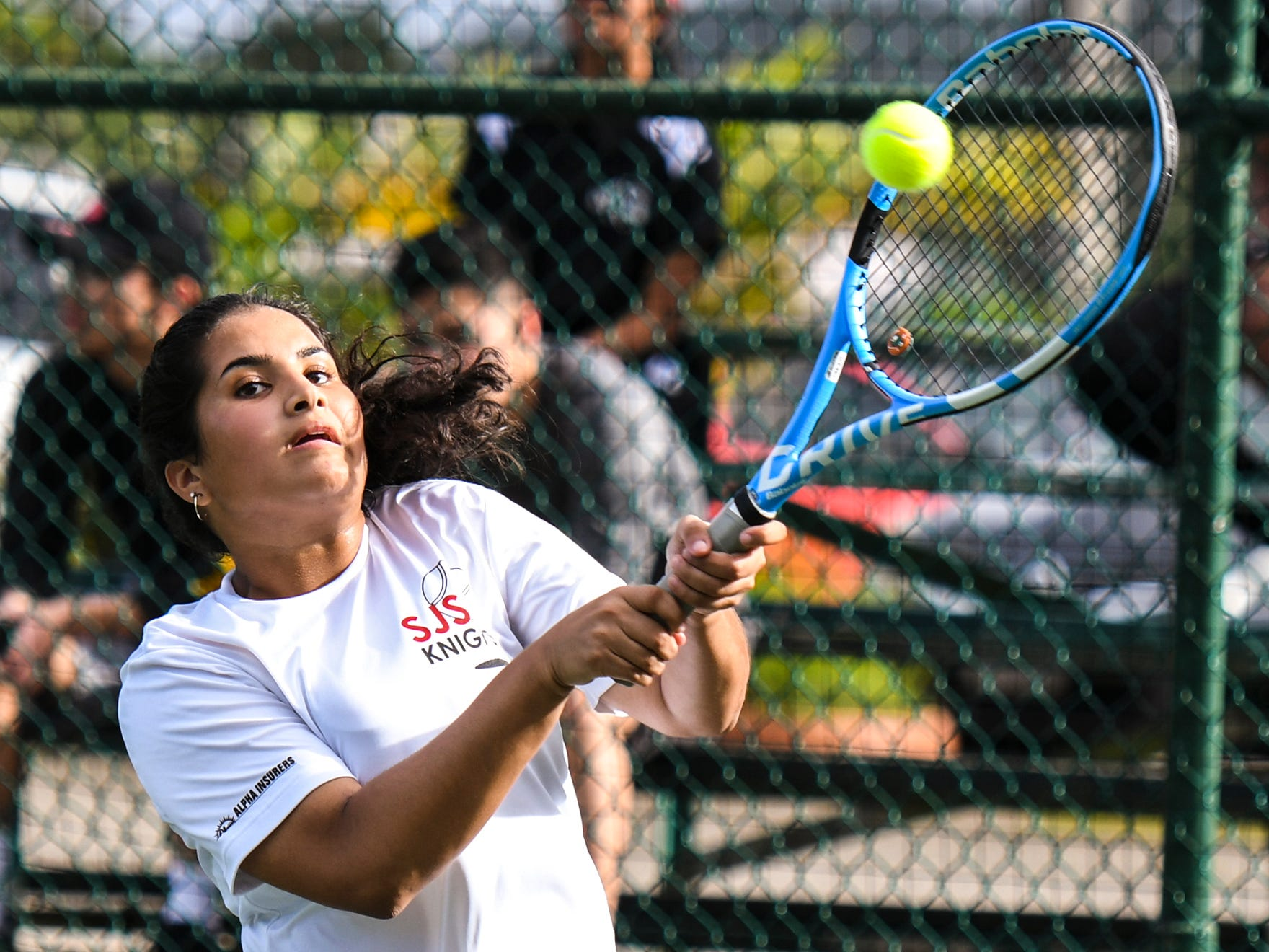 St. John's Knights' Anika Sachdev to her opponent, Academy of Our Lady Guam Cougars' Joycelyn Tenai, during their Interscholastic Athletic Association of Guam tennis singles match at the Rick Ninete Tennis Center in Hagåtna on Thursday, Jan. 31, 2019.