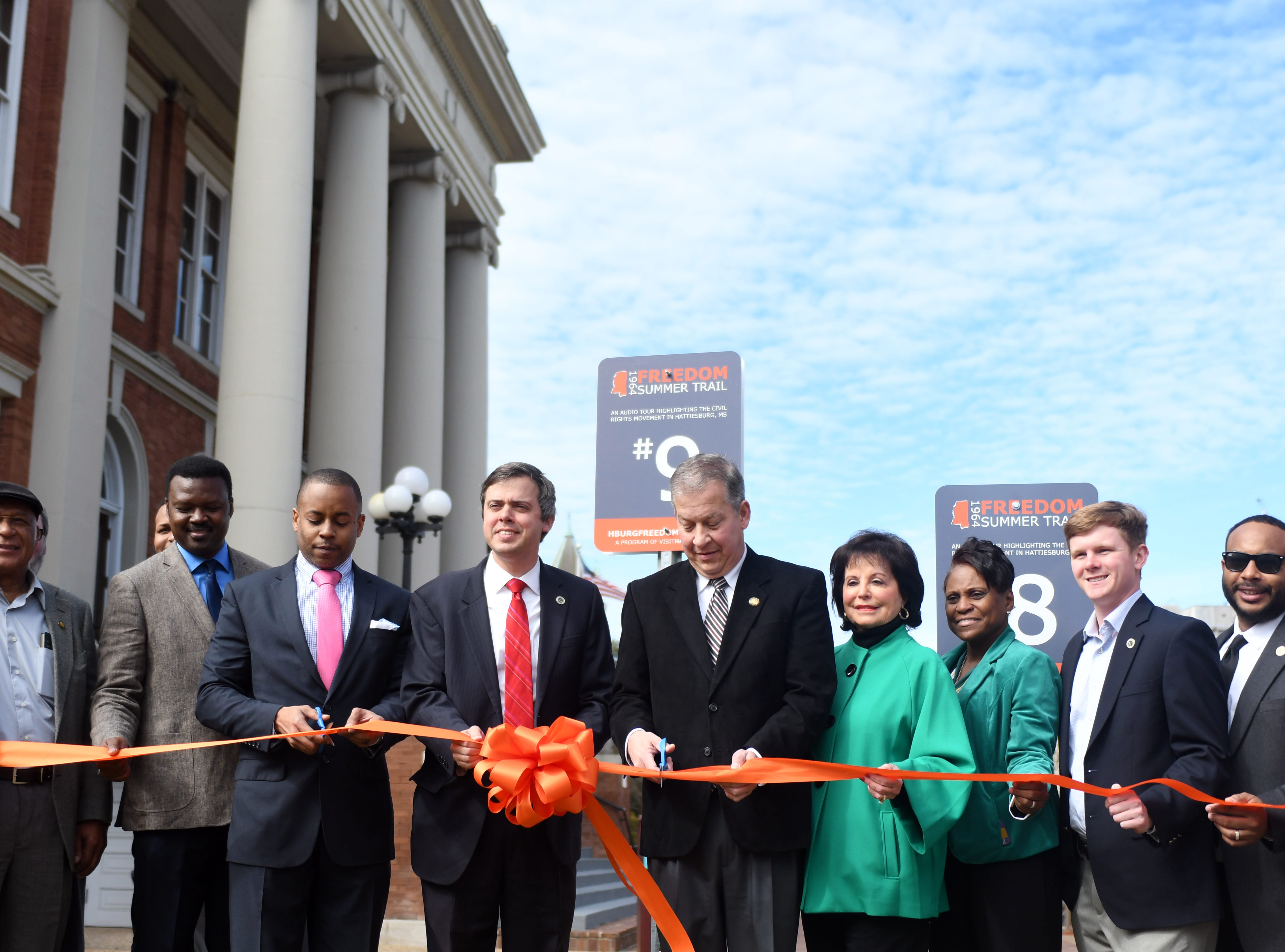 VisitHattiesburg and Hattiesburg officials cut a ribbon for some of the new markers for the 1964 Freedom Summer Trail driving and audio tour around Hattiesburg. There will be 16 stops in Hattiesburg where guest can visit and listen to the history of the Freedom Summer Trail.