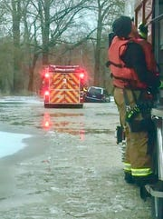The Henderson Fire Department rescues someone in the area of Sunset Lane and Racetrack Road who became stuck in frigid, high water.