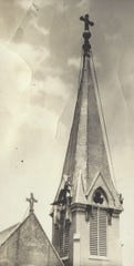 "Dwarfed by a church steeple, Don Johnston (at lower center) and his father, known as ""Operator"" (lower right), work comfortably at heights that many people fear."