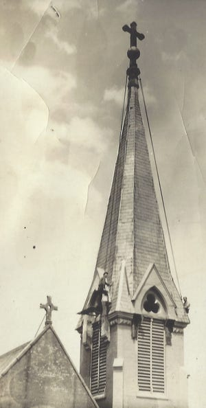 """Dwarfed by a church steeple, PIttsburg Tank & Tower's Don Johnston (at lower center) and his father, known as """"Operator"""" (lower right), worked comfortably at heights that many people fear."""