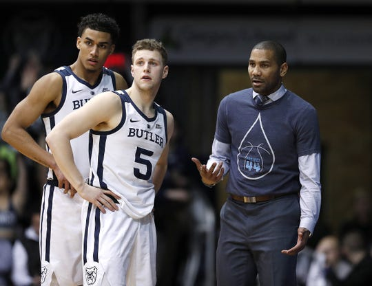 Butler Bulldogs head coach LaVall Jordan talks with guard Paul Jorgensen (5).
