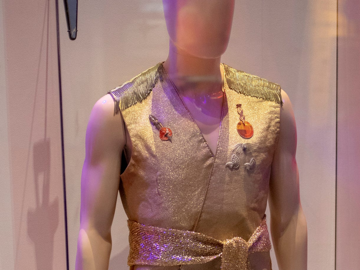 """A uniform worn by an alternate-universe Captain Kirk in the """"Star Trek"""" TV series episode """"Mirror, Mirror"""" is seen at The Children's Museum of Indianapolis, Wednesday, Jan. 23, 2019. The """"Star Trek: Exploring New Worlds"""" exhibit is made up of set pieces, ship models, and outfits used during various Star Trek shows and movies and is on display at the museum from Feb. 2 through April 7, 2019."""