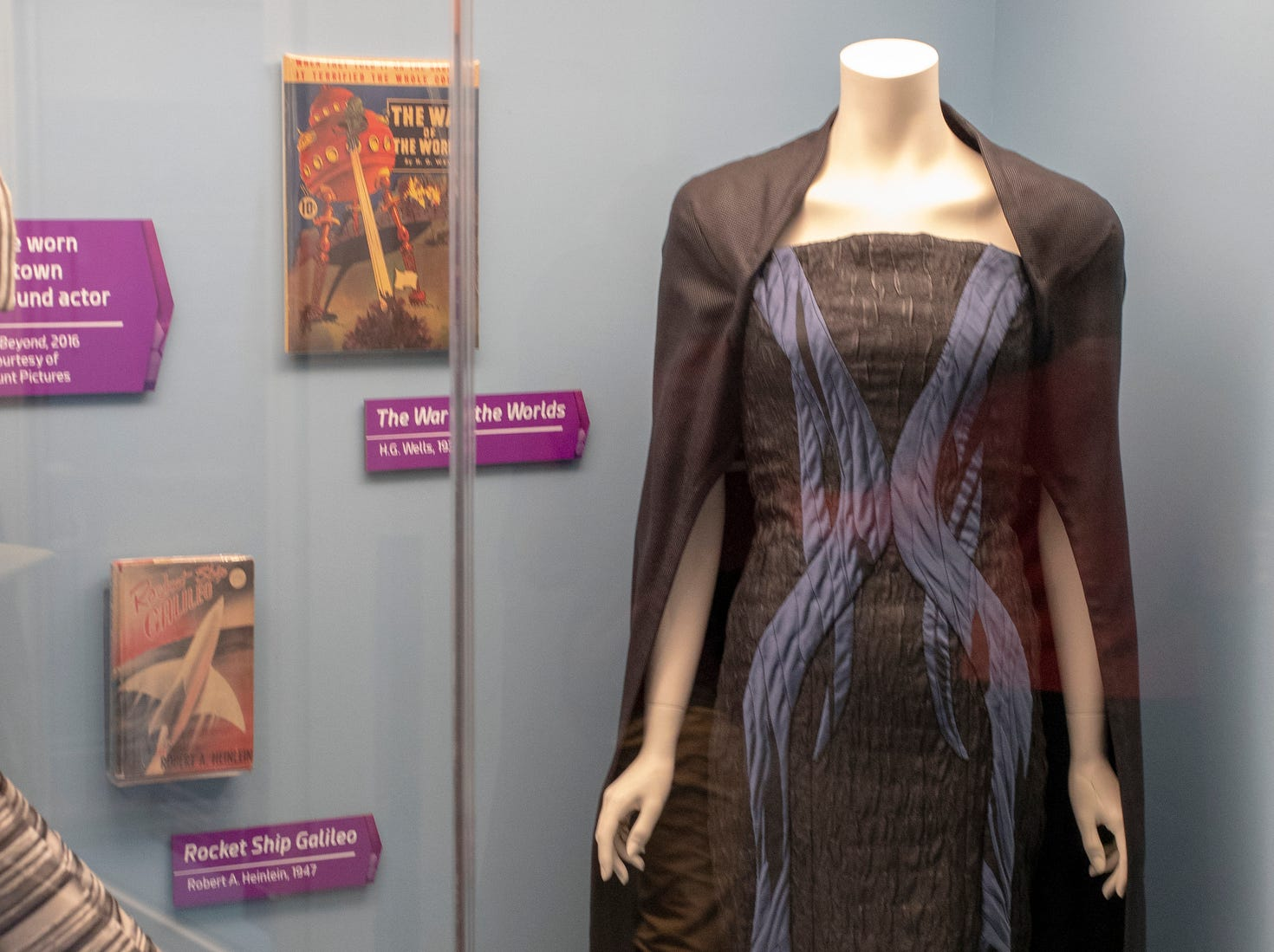 """Clothing and books on display that have been inspired by Star Trek are seen at The Children's Museum of Indianapolis, Wednesday, Jan. 23, 2019. The """"Star Trek: Exploring New Worlds"""" exhibit is made up of set pieces, ship models and outfits used during various Star Trek shows and movies and is on display at the museum from Feb. 2 through April 7, 2019."""
