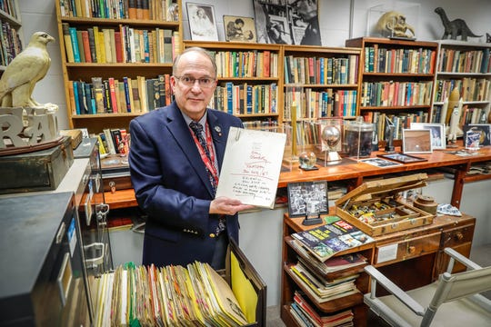 Jon Eller, director of the Center for Ray Ray Bradbury Studies, holds a typed script for a Life Magazine article inside a re-creation of the famous author's home office.