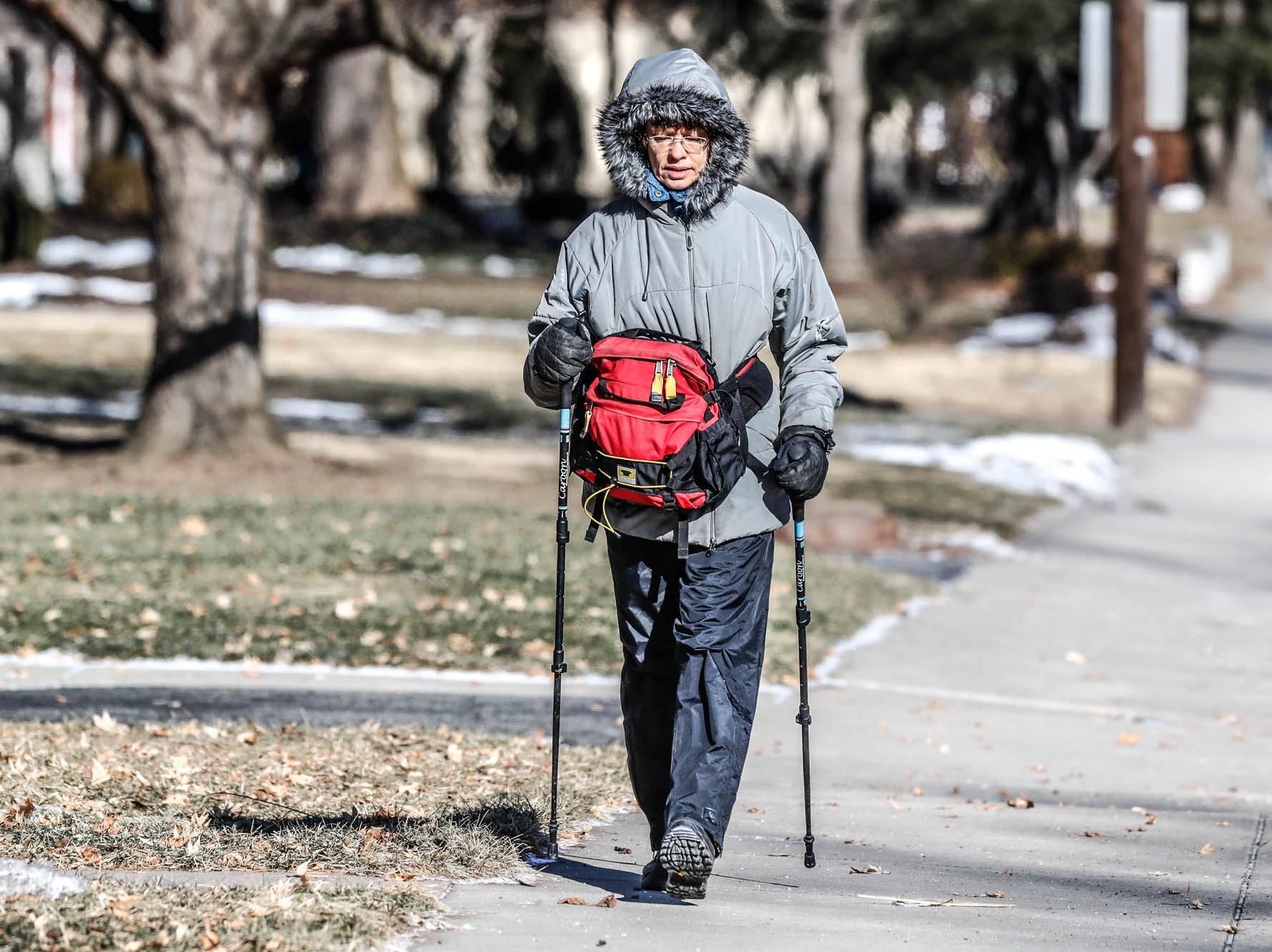 Marti Steussy dresses for the near sub-zero temperatures while walking on the north side of Indianapolis on Thursday, Jan. 31, 2019.