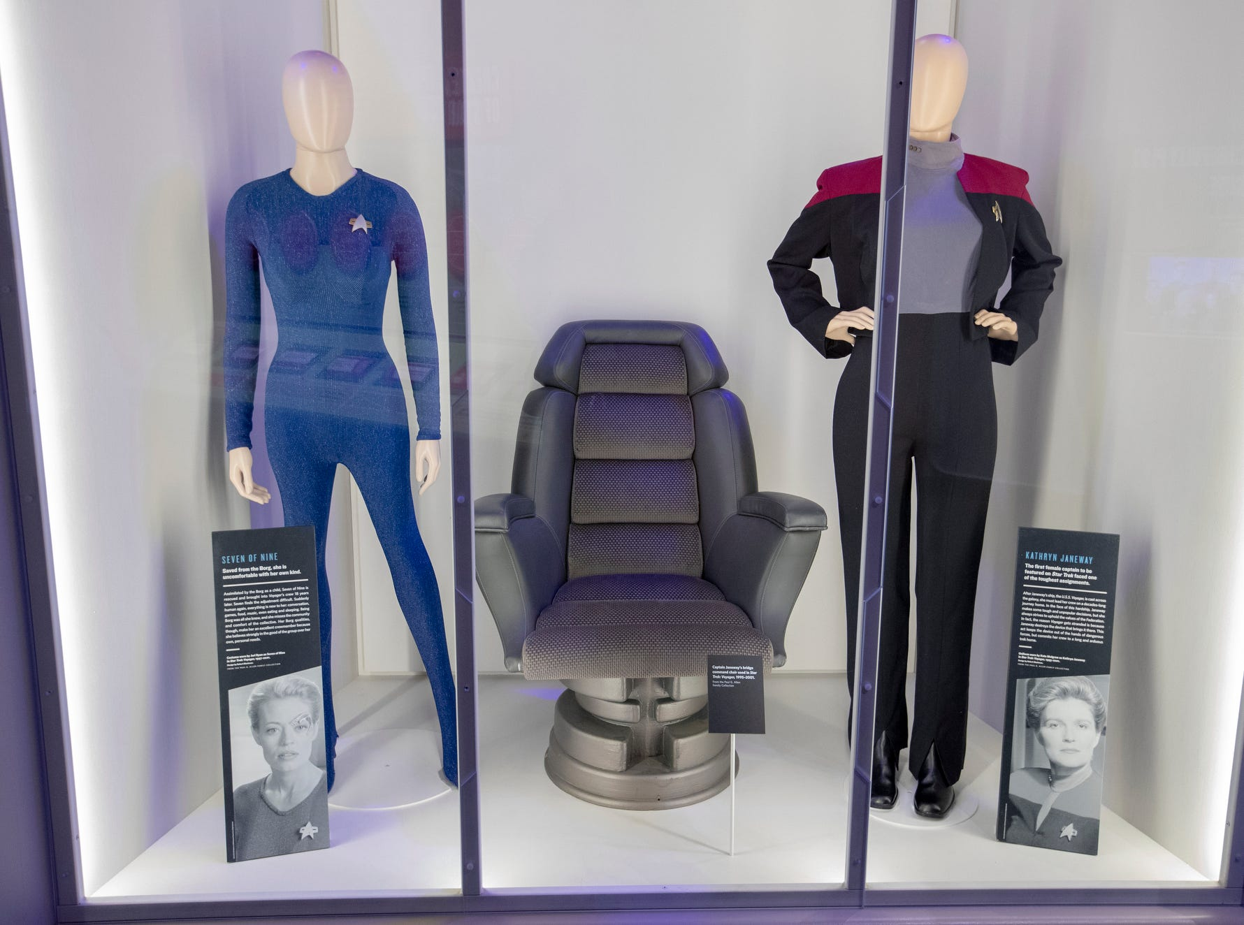 """Uniforms for """"Star Trek: Voyager"""" characters Seven of Nine (left) and Kathryn Janeway are seen at The Children's Museum of Indianapolis, Wednesday, Jan. 23, 2019. The """"Star Trek: Exploring New Worlds"""" exhibit is made up of set pieces, ship models and outfits used during various Star Trek shows and movies and is on display at the museum from Feb. 2 through April 7, 2019."""