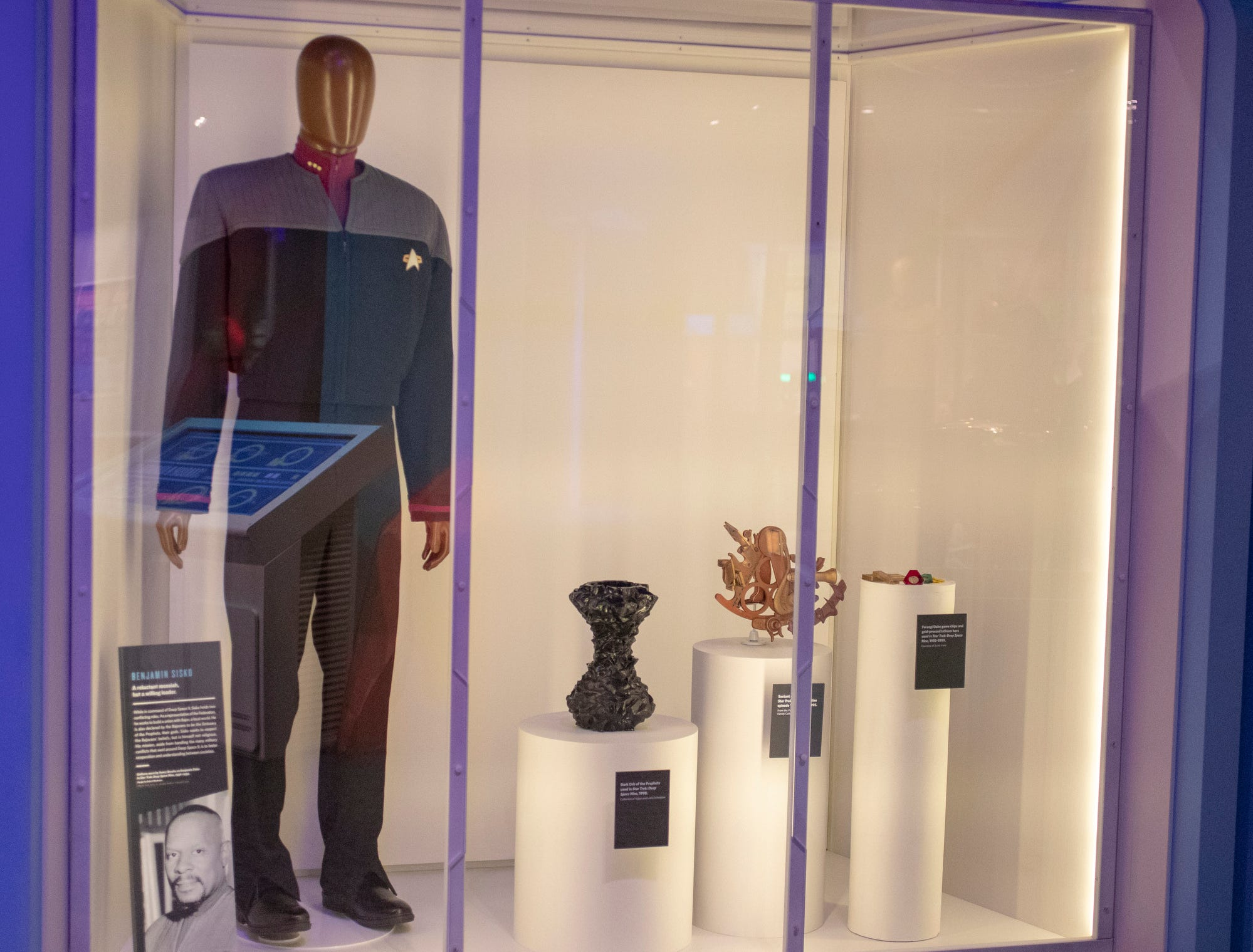 """Benjamin Sisko, a """"Star Trek: Deep Space Nine"""" character played by Evansville native Avery Brooks, is celebrated in this display at The Children's Museum of Indianapolis, Wednesday, Jan. 23, 2019. The """"Star Trek: Exploring New Worlds"""" exhibit is made up of set pieces, ship models and outfits used during various Star Trek shows and movies and is on display at the museum from Feb. 2 through April 7, 2019."""
