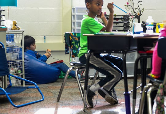 Yura Hobo, a second-grader in Becky Yoder's class, takes a 90-second break to refresh during class at Hinkle Creek Elementary in Noblesville, Ind., Friday, Jan. 18, 2019. Students may choose to take a brief break as needed, where fidget tools are available to help clear students' minds and better their focus.