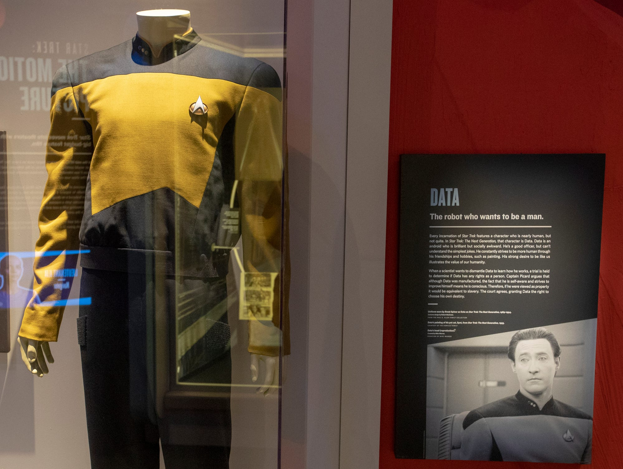 """A uniform worn by the character Data, a character in """"Star Trek: The Next Generation,"""" is seen at The Children's Museum of Indianapolis, Wednesday, Jan. 23, 2019. The """"Star Trek: Exploring New Worlds"""" exhibit is made up of set pieces, ship models and outfits used during various Star Trek shows and movies and is on display at the museum from Feb. 2 through April 7, 2019."""