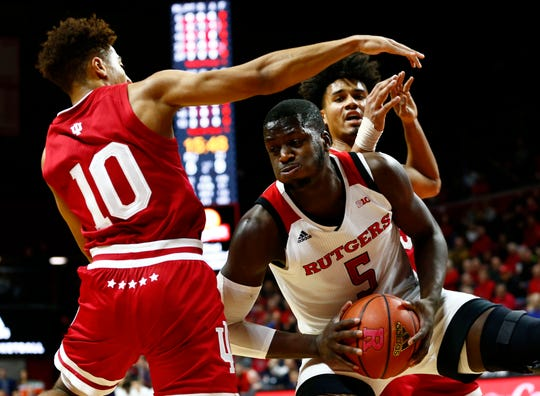 Indiana Hoosiers guard Rob Phinisee (10) defends against Rutgers Scarlet Knights forward Eugene Omoruyi (5).