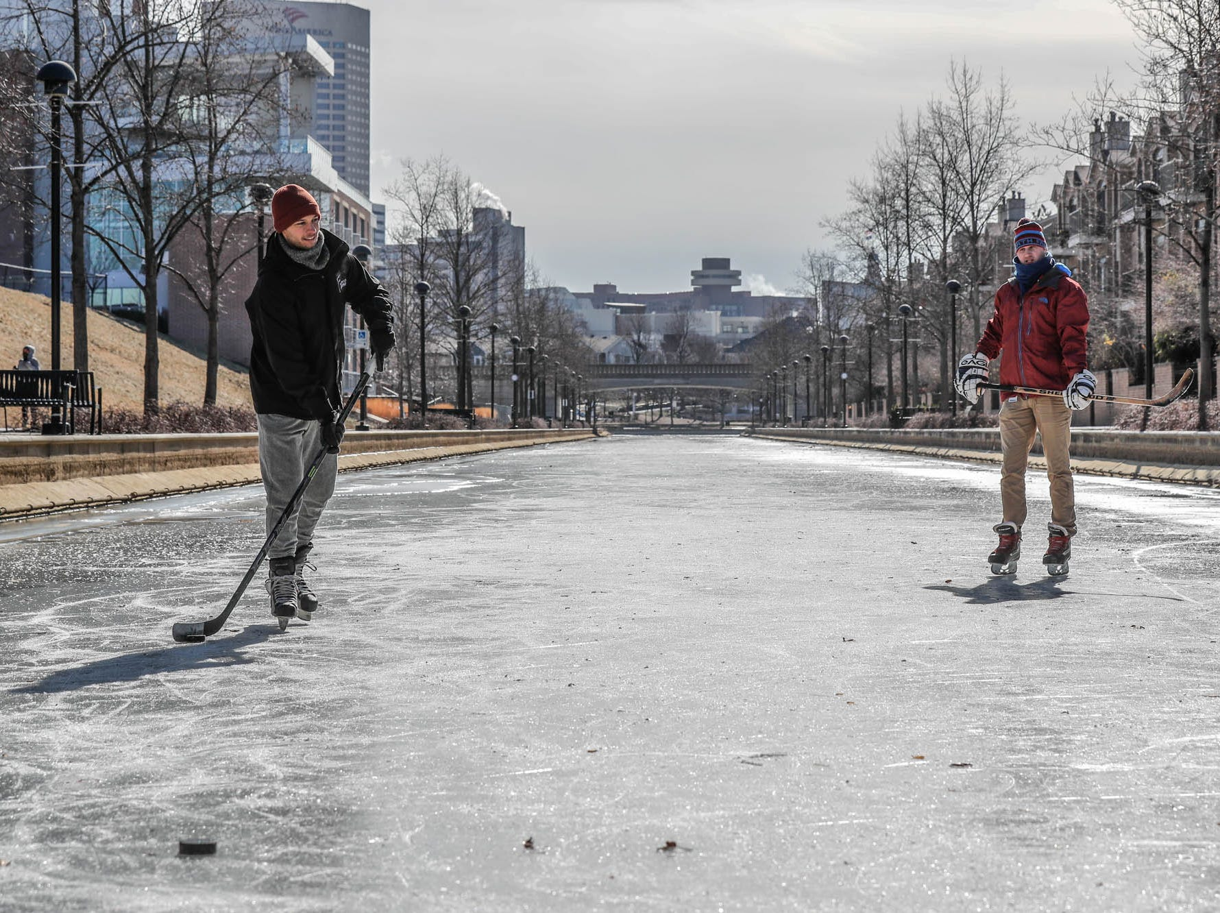 Left to right, friends Charlie Hornett, Jackson Richey and Chase Fairchild, not shown here, get some free ice time to practice hockey skills on the downtown Indianapolis canal on Thursday, Jan. 31, 2019.