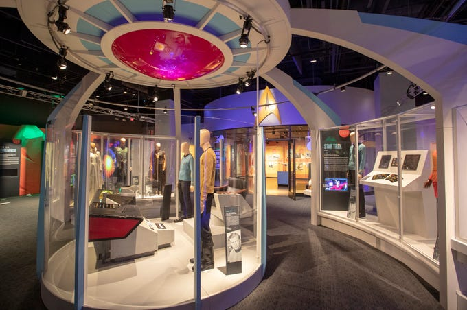 """The main display area for """"Star Trek: Exploring New Worlds"""" is seen at The Children's Museum of Indianapolis, Wednesday, Jan. 23, 2019. The exhibit is made up of set pieces, ship models and outfits used during various Star Trek shows and movies and is on display at the museum from Feb. 2 through April 7, 2019."""