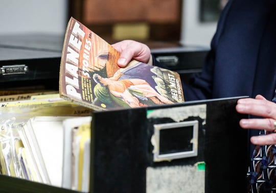 """Jon Eller, director of The Center for Ray Ray Bradbury Studies, pulls a copy of """"Planet Stories"""" from the archive inside the Center for Ray Bradbury Studies located at Cavanaugh Hall on the IUPUI."""