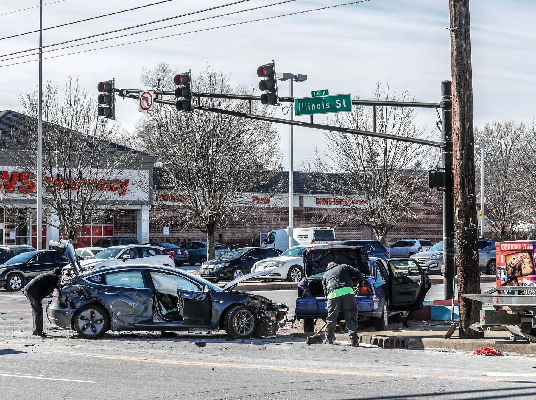 A multi-vehicle crash at the intersection of Illinois Street and 38th St. included a Tesla on Thursday, Jan. 31, 2019. The Tesla's owner had waited over a year for the car and could be seen with tears running down his cheeks in the sub-zero temperatures.